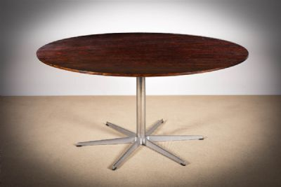 A CIRCULAR 6 STAR SERIES DINING TABLE at de Veres Auctions