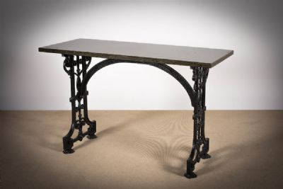 A CAST IRON TABLE at deVeres Auctions