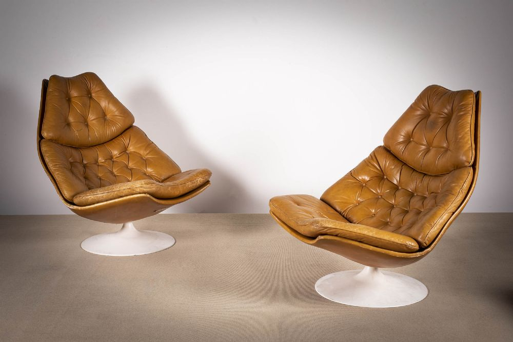 A PAIR OF TANNED LEATHER SWIVEL CHAIRS