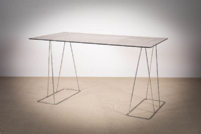 A SMOKED GLASS TOPPED DESK at deVeres Auctions