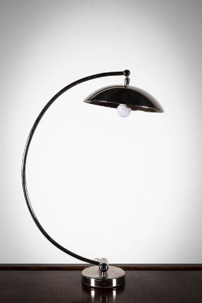 A CHROME ARCHED DESK	LAMP at deVeres Auctions