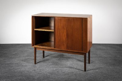 A TEAK SIDE CABINET at deVeres Auctions