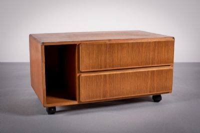 A TEAK LOW CABINET by Komfort  at de Veres Auctions