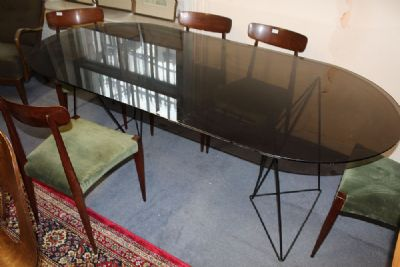A SMOKED GLASS DINING TABLE at de Veres Auctions