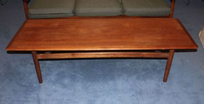 A TEAK COFFEE TABLE at de Veres Auctions